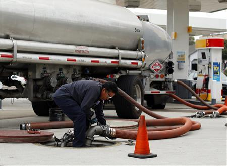 A worker delivers a new shipment of gasoline to a gas station in Encinitas, California, in this October 8, 2012 file photo. U.S. motorists searching for someone to blame for the highest gasoline prices ever at this time of year have an easy target: hedge funds who have been quietly amassing winning bets on hundreds of millions of barrels of oil. REUTERS/Mike Blake/Files