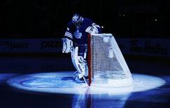 Toronto Maple Leafs goalie James Reimer is seen in the pre-game spotlight before they play the Philadelphia Flyers in their NHL hockey game in Toronto, February 11, 2013. REUTERS/Mark Blinch