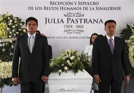 People stand next to the coffin containing the remains of Julia Pastrana in Sinaloa de Leyva February 12, 2013. REUTERS/Stringer