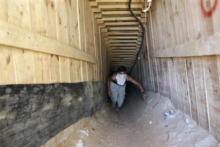 A Palestinian smuggler walks inside inside a tunnel beneath the Egyptian-Gaza border in Rafah, in the southern Gaza Strip September 17, 2012. REUTERS/Ibraheem Abu Mustafa/Files