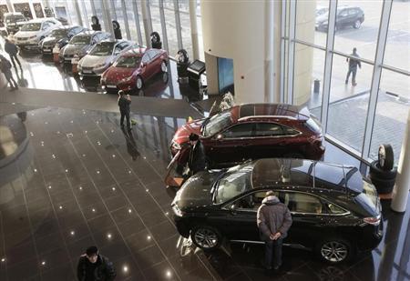 People visit a Lexus cars sales and show room in Krasnoyarsk, February 6, 2013. REUTERS/Ilya Naymushin