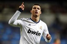 Real Madrid's Cristiano Ronaldo celebrates after scoring his second goal against Sevilla during their Spanish first division soccer match at Santiago Bernabeu stadium in Madrid February 9, 2013. REUTERS/Sergio Perez