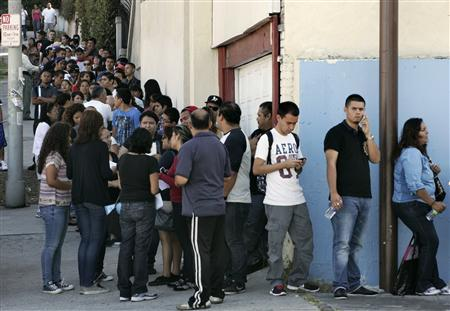 People line up for assistance with paperwork for the Deferred Action for Childhood Arrivals program at the Coalition for Humane Immigrant Rights of Los Angeles in Los Angeles, California, August 15, 2012. REUTERS/Jonathan Alcorn