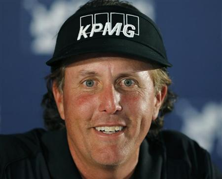 U.S. golfer Phil Mickelson speaks during a news conference at the Farmers Insurance Open in San Diego, California, January 23, 2013. REUTERS/Mike Blake