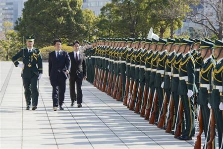 Japan's Prime Minister Shinzo Abe (2nd L) and Defence Minister Itsunori Onodera (3rd L) review an honour guard before a flag return ceremony to mark the return of the Japan Self-Defence Force (JSDF) troops, who were stationed with the United Nations Disengagement Observer Force (UNDOF) in Golan Heights, at the Defence Ministry in Tokyo January 20, 2013. REUTERS/Japan Ministry of Defense/Handout/Files