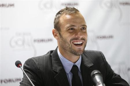 Paralympic and Olympic runner Oscar Pistorius of South Africa speaks during a news conference after the official opening ceremony of the Doha GOALS forum in Doha December 11, 2012. REUTERS/Fadi Al-Assaad/Files