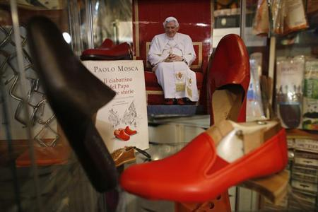 Red shoes made by shoemaker Antonio Arellano for Pope Benedict XVI are displayed in his shop in downtown Rome February 14, 2013. REUTERS/Tony Gentile