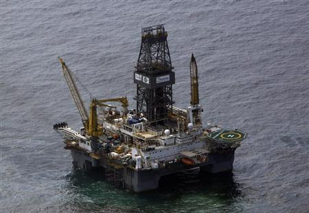 The Transocean Development Driller III, which is drilling the relief well, is seen surrounded by part of the oil slick covering the site of the BP oil spill in the Gulf of Mexico, off the coast of Louisiana May 12, 2010. REUTERS/Rick Wilking