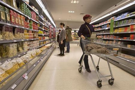 Shoppers browse the aisles in the Canary Wharf store of Waitrose in London January 23, 2013. REUTERS/Neil Hall