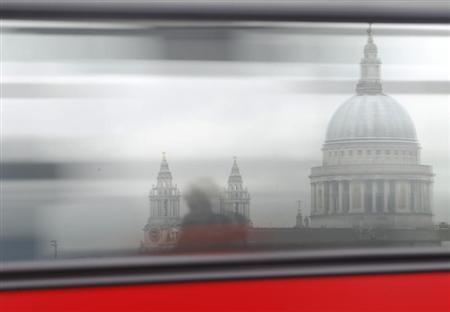 A bus passes St Paul's Cathedral in London January 29, 2013. REUTERS/Luke Macgregor