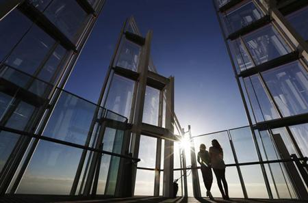 Women look out at the city from The View gallery at the Shard, western Europe's tallest building, in London January 9, 2013. REUTERS/Luke Macgregor