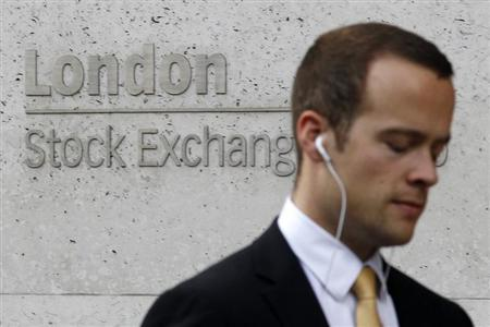 A pedestrian walks past the London Stock Exchange August 5, 2011. REUTERS/Suzanne Plunkett
