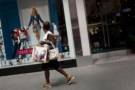 A woman walks past an Aeropostale store in Times Square in New York, July 27, 2012. REUTERS/Andrew Burton