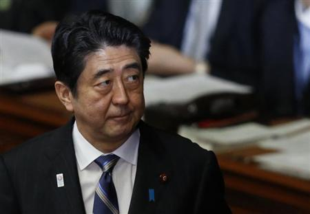 Japan's Prime Minister Shinzo Abe attends a lower house plenary session at the parliament in Tokyo February 5, 2013. REUTERS/Issei Kato