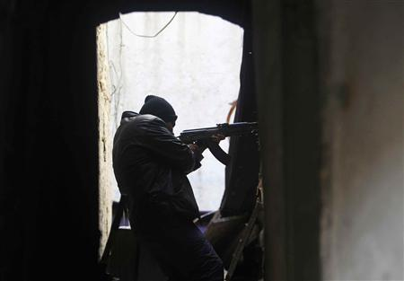 A member of the Free Syrian Army takes aim with his gun during clashes with forces loyal to Syria's President Bashar al-Assad, in the old city of Aleppo February 15, 2013. REUTERS/Muzaffar Salman