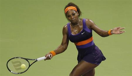Serena Williams of the U.S. hits a return to Petra Kvitova of the Czech Republic during their women's quarter-final match at the Qatar Open tennis tournament in Doha February 15, 2013. REUTERS/Fadi Al-Assaad