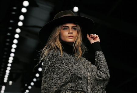 Model Cara Delevingne presents a creation from the Issa Autumn/Winter 2013 collection during London Fashion Week, February 16, 2013. REUTERS/Olivia Harris (BRITAIN - Tags: FASHION)