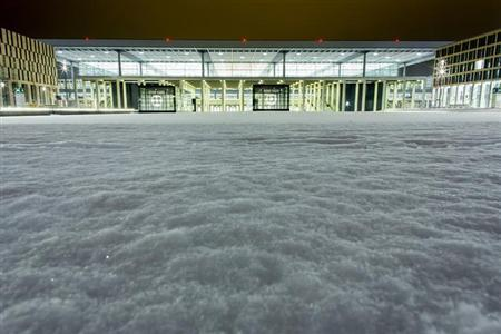 A general view shows the terminal building of the future BER International Airport in Schoenefeld outside Berlin, January 16, 2013. REUTERS/Thomas Peter