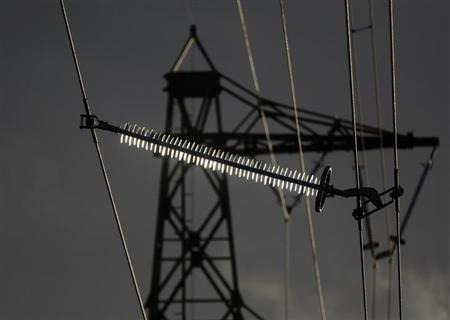 A power pole is pictured in the western city of Meckenheim January 30, 2013. E.ON, Germany's top utility, said on Wednesday, core profit could fall by up to 15 percent this year, burdened by weakening energy demand in Europe as well as slumping power prices. REUTERS/Ina Fassbender (GERMANY - Tags: ENERGY BUSINESS)