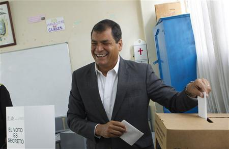 Ecuador's President Rafael Correa reacts as he casts his ballot at a polling station at San Francisco de Quito School in Quito February 17, 2013. Ecuadoreans vote for president on Sunday in a ballot expected to hand incumbent Correa a new term to advance his socialist agenda of heavy government spending and expansion of state power that critics slam as creeping authoritarianism. REUTERS/Guillermo Granja
