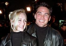"Actor Dean Cain escorts his girlfriend, country music singer Mindy McCready, to the premiere of the new horror film ""Scream 2"" at Mann's Chinese Theatre in Hollywood, California in this December 10, 1997 file photograph. McCready has died aged 37 from an apparently self-inflicted gunshot wound, an Arkansas sheriff said on February 17, 2013. REUTERS/Fred Prouser/Files"