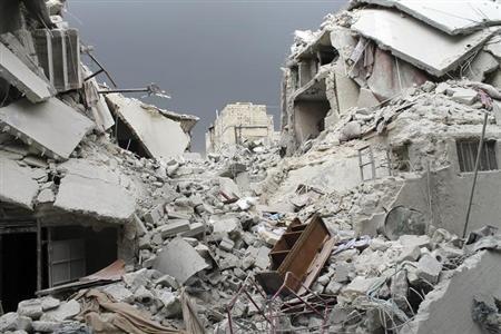 Damaged buildings are seen after air force shelling in Karam Al-Tarrab neighborhood near Aleppo International Airport February 15, 2013. Picture taken February 15, 2013. REUTERS/Malek Al Shemali