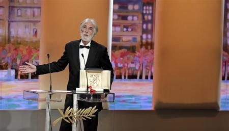 Director Michael Haneke reacts after receiving the Palme d'Or award for the film ''Amour'' (Love) during the awards ceremony of the 65th Cannes Film Festival, May 27, 2012. REUTERS/Eric Gaillard/Files