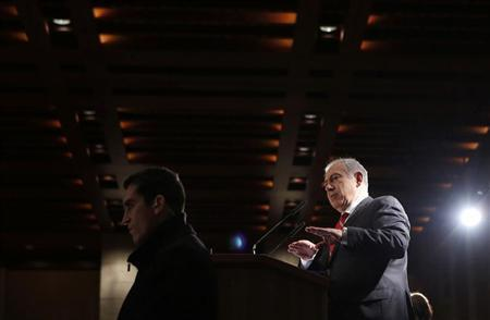 Israel's Prime Minister Benjamin Netanyahu (R) addresses a meeting of the Jewish Agency's Board of Governors in Jerusalem February 18, 2013. REUTERS/Baz Ratner