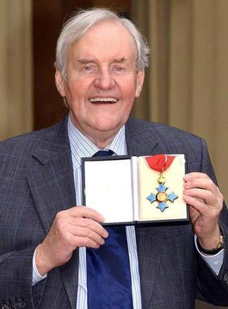 Veteran British actor Richard Briers, 69, poses with his CBE (Commander of the Order of the British Empire) medal after a ceremony with Britain's Queen Elizabeth II at Buckingham Palace, London, November 13, 2003. REUTERS/POOL/Kirsty Wigglesworth