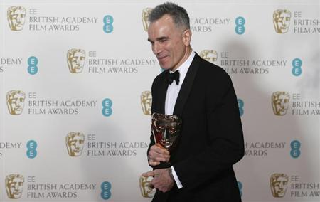 Daniel Day-Lewis celebrates after winning the Best Actor award for ''Lincoln'' at the British Academy of Film and Arts (BAFTA) awards ceremony at the Royal Opera House in London February 10, 2013. REUTERS/Suzanne Plunkett