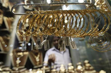 A worker stands at his gold jewellery shop at the market of Khan el-Khalili in Old Cairo October 10, 2012. REUTERS/Amr Abdallah Dalsh/Files