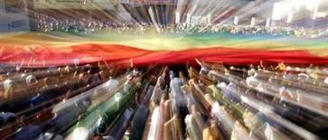File photo of people carrying a rainbow flag march during the ninth annual Gay and Lesbian Pride parade in a main avenue in Sao Paulo, Brazil, May 29, 2005. REUTERS/Paulo Whitaker