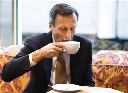 Daniel Vasella, chairman of Swiss drugmaker Novartis, drinks coffee before the annual news conference in Basel, January 23, 2013. REUTERS/Michael Buholzer/Files