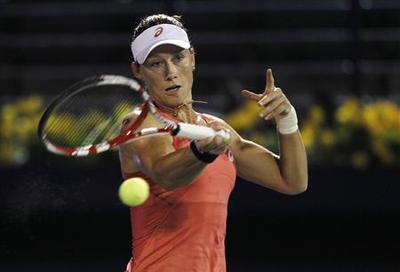 Stosur eases through in Dubai, Azarenka pulls out