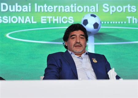Argentine former soccer star Diego Maradona attends the final session of the first day of the seventh Dubai International Sports Conference in Dubai, December 28, 2012. REUTERS/Mohammed Abu Omar
