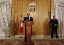 Hamadi Jebali, lors d'une conférence de presse à Tunis, lundi. Le Premier ministre tunisien a démissionné mardi après l'échec de son projet de formation d'un gouvernement de techniciens visant à mettre fin à la crise politique. /Photo prise le 18 février 2013/REUTERS/Zoubeir Souissi