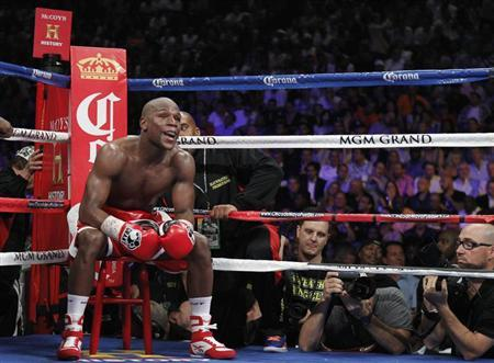 Floyd Mayweather Jr. of the U.S. sits on a stool as he waits for a round to start during his title fight against WBA super welterweight champion Miguel Cotto of Puerto Rico at the MGM Grand Garden Arena in Las Vegas, Nevada May 5, 2012. REUTERS/Steve Marcus