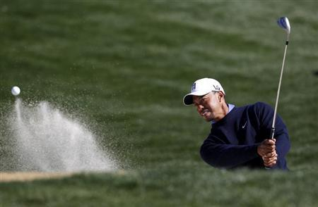 Tiger Woods of the U.S. hits from the sand during a practice round for the WGC-Accenture Match Play Championship golf tournament in Marana, Arizona February 19, 2013. REUTERS/Matt Sullivan