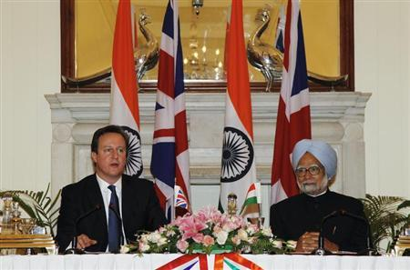 Britain's Prime Minister David Cameron (L) speaks with the media as his Indian counterpart Manmohan Singh looks on after their meeting in New Delhi February 19, 2013. REUTERS/B Mathur