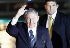 Cuba's President Raul Castro waves to the media before an official dinner at La Moneda Presidential Palace during the summit of the Community of Latin American and Caribbean States (CELAC) in Santiago, January 27, 2013. REUTERS/Andres Stapff