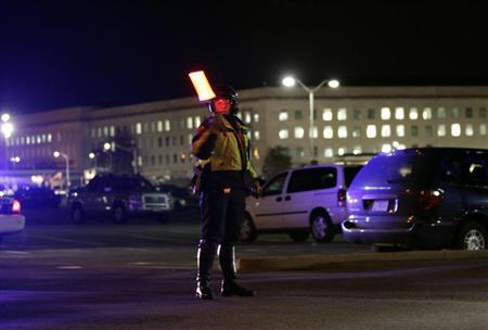 A police officer directs traffic at a roadblock around the Pentagon in Washington March 4, 2010. REUTERS/Yuri Gripas