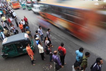 People wait to commute on different modes of public transportation before iftar (breaking fast) during the holy month of Ramadan in Dhaka August 1, 2012. REUTERS/Andrew Biraj