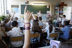 Les Français doutent de la capacité de leur commune à mettre en place la réforme des rythmes scolaires qui instaure notamment le retour à la semaine de quatre jours et demi, selon un sondage Harris Interactive pour le syndicat SNUipp-FSU publié mercredi. /Photo d'archives/REUTERS/Charles Platiau