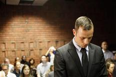 "Oscar Pistorius stands in the dock during a break in court proceedings at the Pretoria Magistrates court, February 20, 2013. ""Blade Runner"" Pistorius, a double amputee who became one of the biggest names in world athletics, was applying for bail after being charged in court with shooting dead his girlfriend, 30-year-old model Reeva Steenkamp, in his Pretoria house. REUTERS/Siphiwe Sibeko"