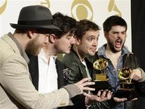 """Mumford & Sons pose with their awards for Album of the Year for """"Babel"""" and Best Long Form Music Video for """"Big Easy Express"""" backstage at the 55th annual Grammy Awards in Los Angeles, California February 10, 2013. REUTERS/Jonathan Alcorn"""