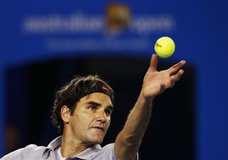 Roger Federer of Switzerland serves to Andy Murray of Britain during their men's singles semi-final match at the Australian Open tennis tournament in Melbourne January 25, 2013. REUTERS/Damir Sagolj/Files