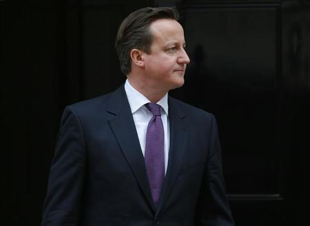 Britain's Prime Minister David Cameron waits to greet his Pakistani counterpart, Raja Pervez Ashraf, at Number 10 Downing Street in London February 12, 2013. REUTERS/Andrew Winning