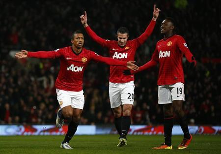 Manchester United's Nani (L) celebrates with teammates Robin van Persie (C) and Danny Welbeck after scoring his side's first goal during their FA Cup soccer match against Reading at Old Trafford in Manchester, northern England, February 18, 2013. REUTERS/Darren Staples