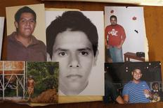 Photographs of five of the six young men abducted by soldiers are seen at a desk in Iguala, in the Mexican state of Guerrero February 20, 2013. REUTERS/Tomas Bravo