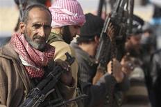 Ribelli dell'Esercito di liberazione siriana. REUTERS/Muzaffar Salman